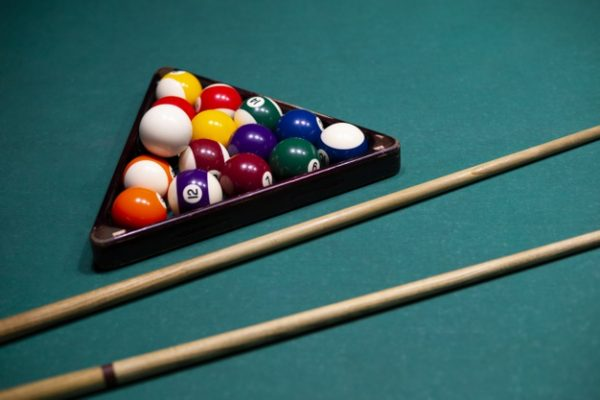 high-angle-arrangement-with-pool-balls-cues_23-2148299194